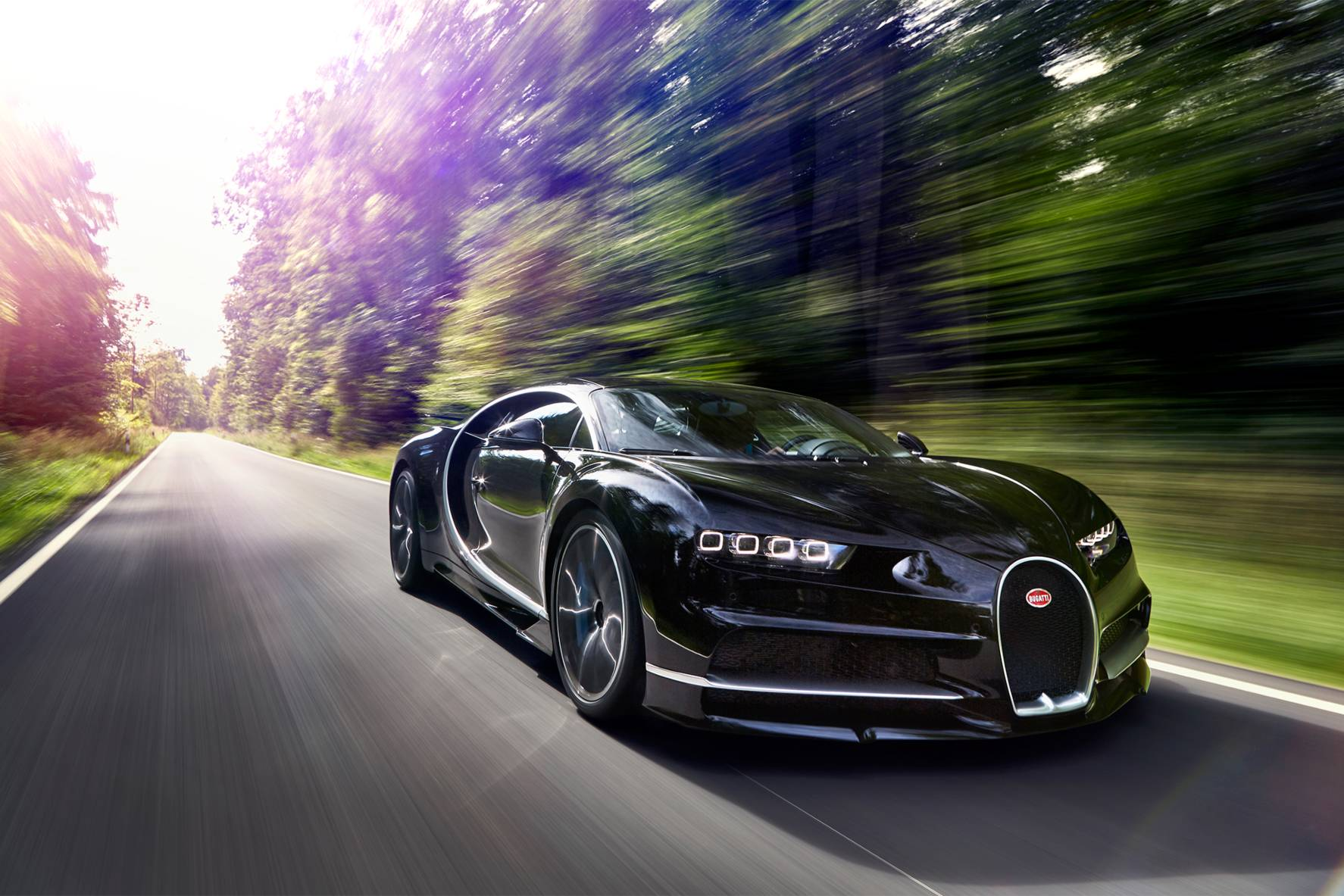 2017-Bugatti-Chiron-front-three-quarter-in-motion-03